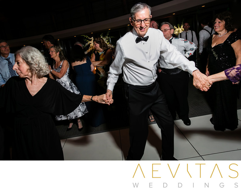 Father dancing in circle at Jewish wedding reception