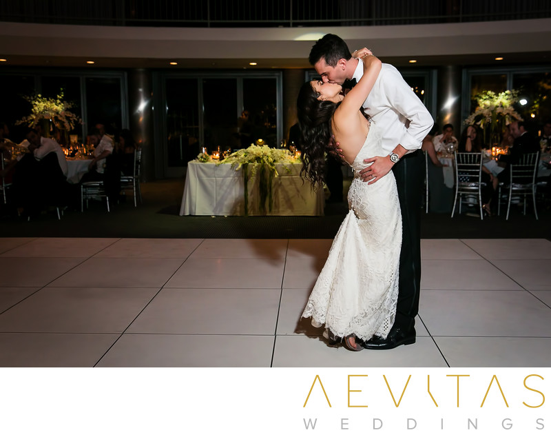 Couple kiss at end of wedding reception first dance