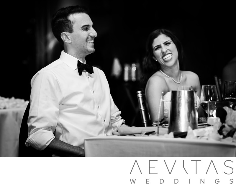 Black and white couple reactions at sweetheart table