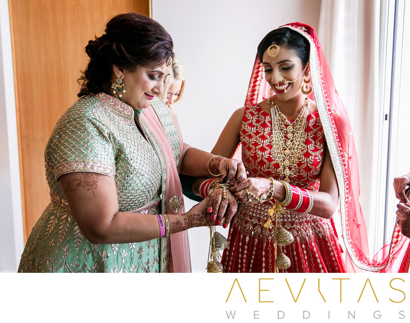 Special moment between bride and mom at Indian wedding