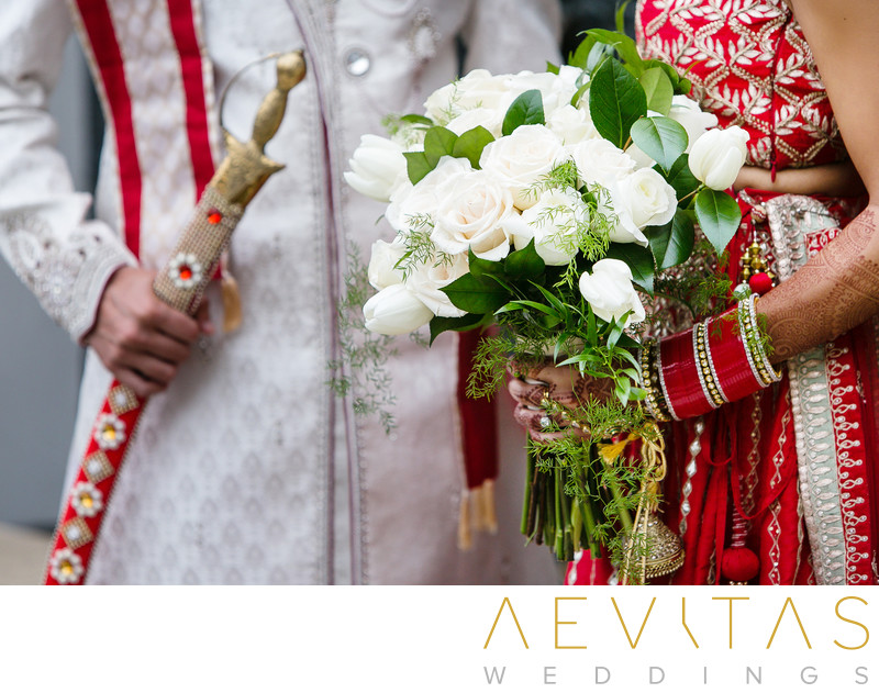 Close-up photo of bouquet and sword at Indian wedding