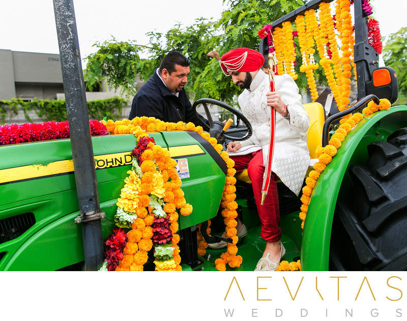 Indian groom driving green tractor at Pasea Hotel