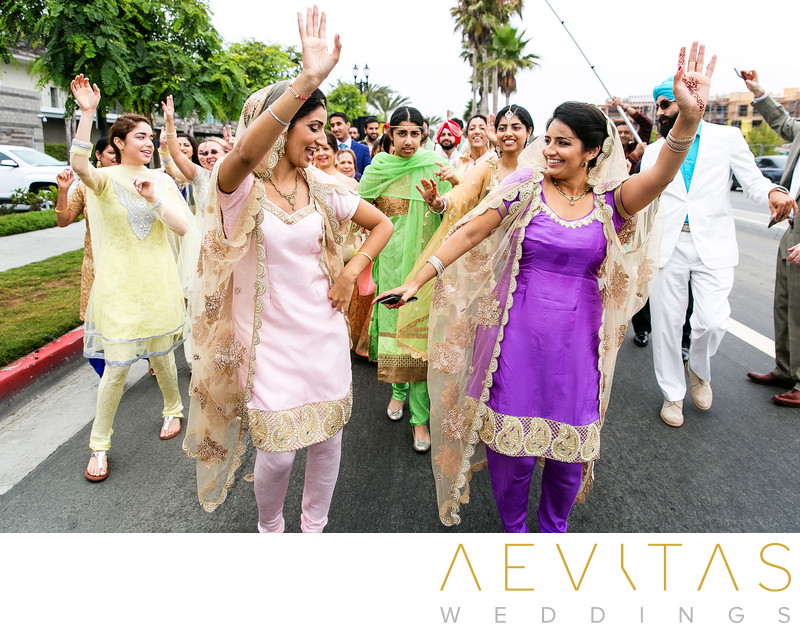 Women dancing in sari during Huntington Beach Baraat
