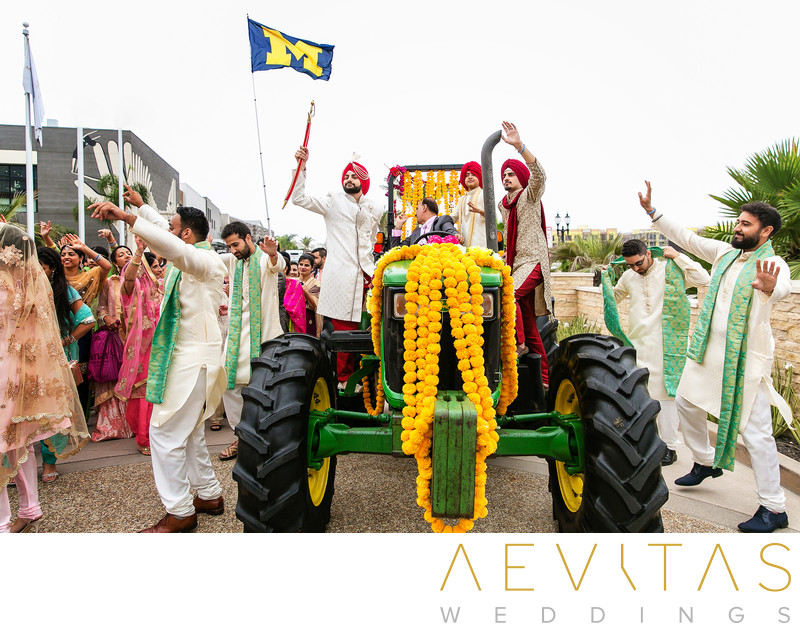 Groom arrives at Pasea Hotel Baraat on green tractor