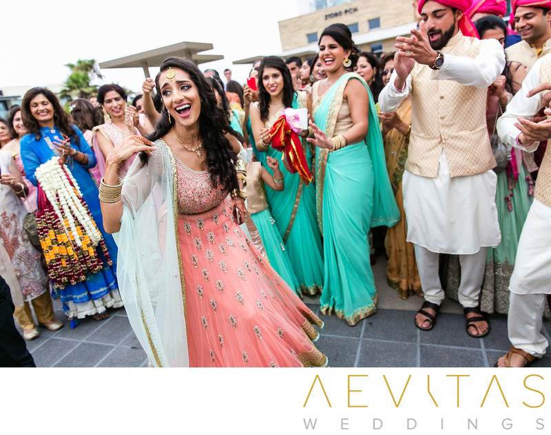 Sister dancing at Indian wedding Baraat ceremony