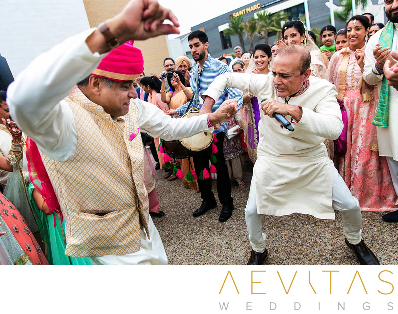 Fathers dancing at Baraat in Huntington Beach