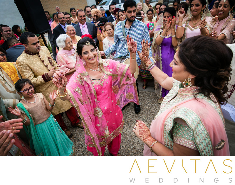 Mother-of-the-groom dancing at Baraat ceremony