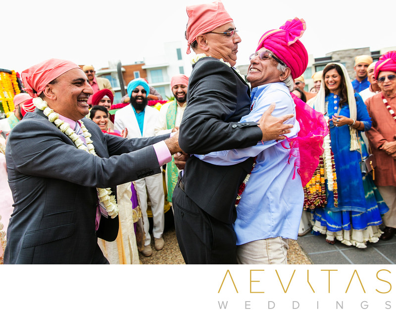 Men lift one another during Indian wedding game