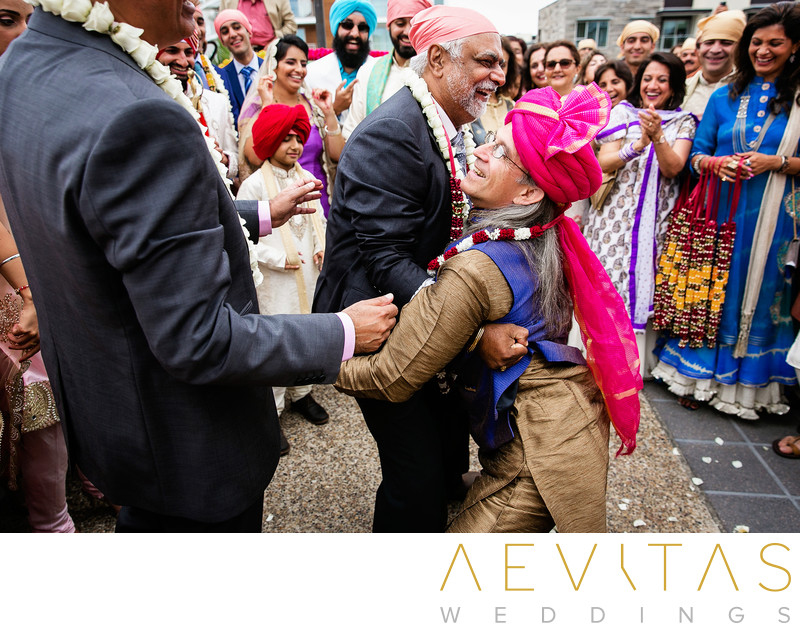 Candid photo of Indian wedding game by LA photographer