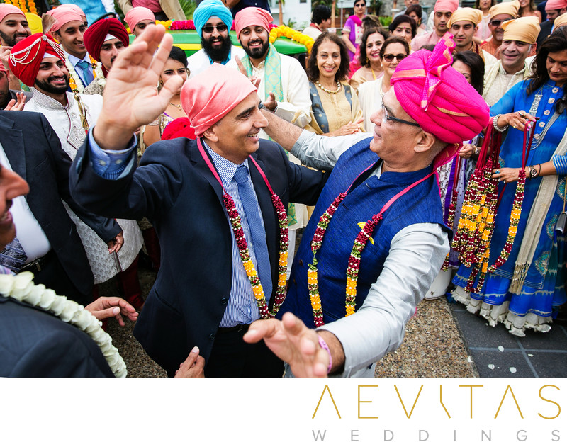 Creative photo of two men dancing at Sikh wedding