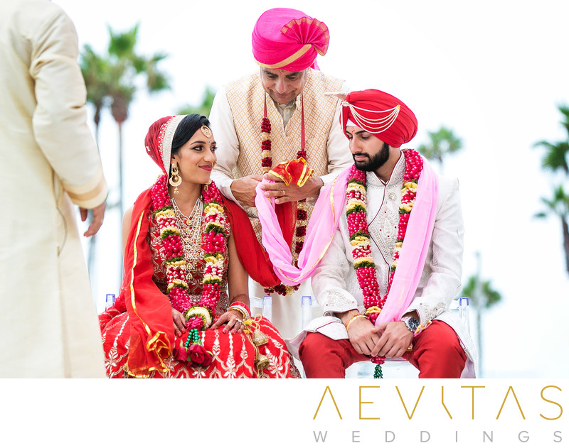 Father unites bride and groom with cloth Indian wedding