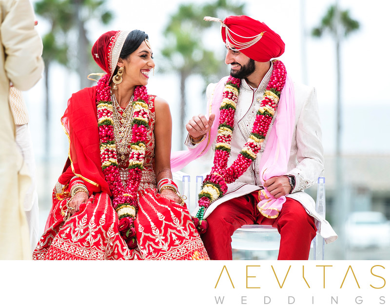 Playful couple moment at Hindu wedding ceremony