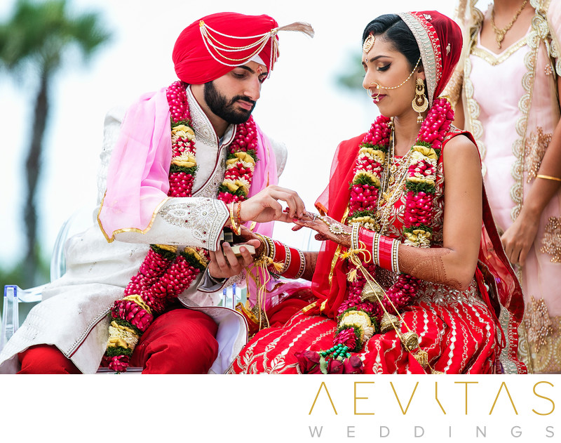 Couple exchange rings at Indian wedding ceremony