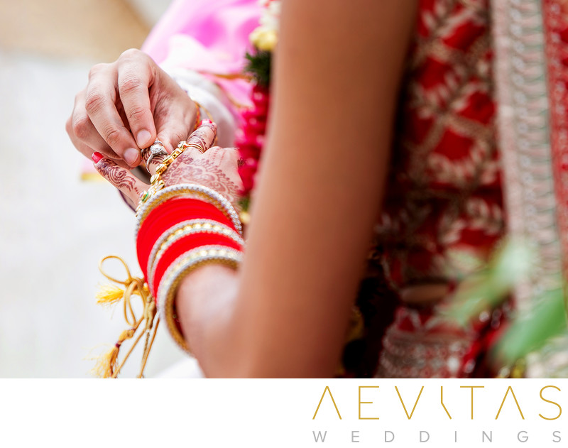 Close-up photo of ring exchange at Indian wedding