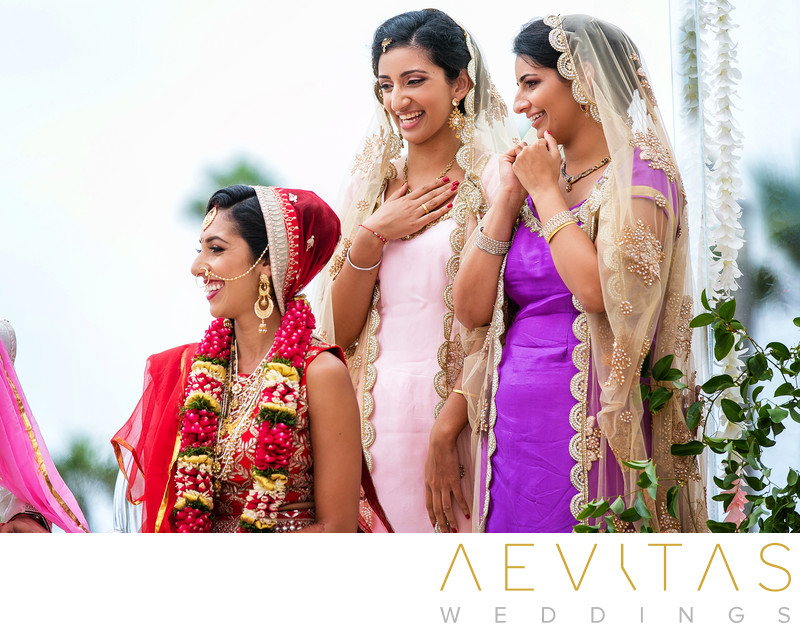 Sister reactions with bride at Hindu wedding ceremony