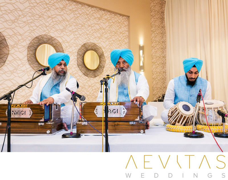 Musicians with blue turbans at Sikh wedding ceremony