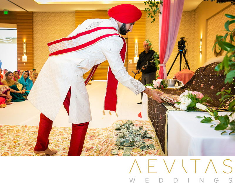 Groom makes offering at Sikh wedding ceremony