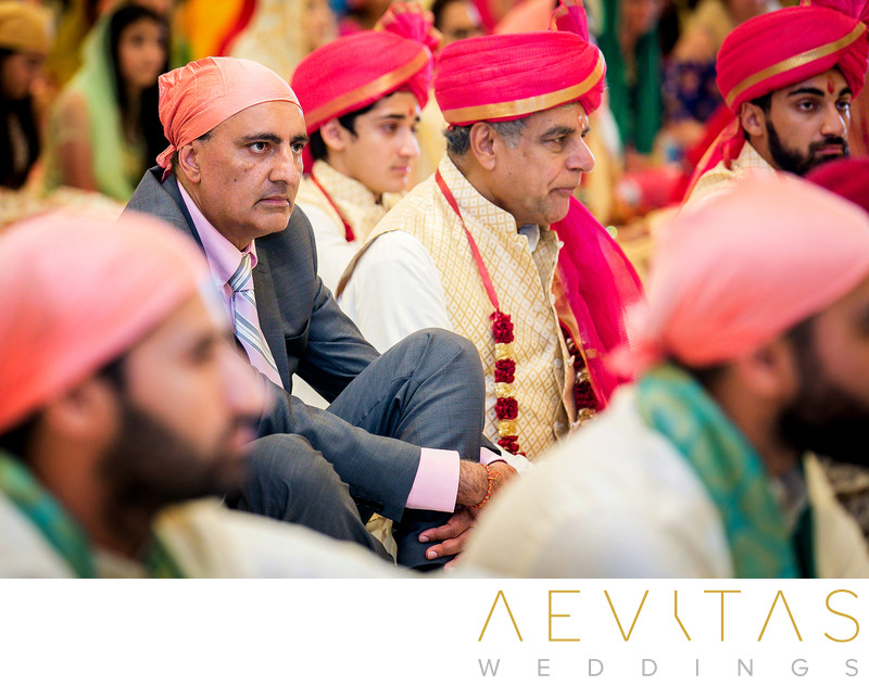 Sikh and Hindu fathers at Indian wedding ceremony