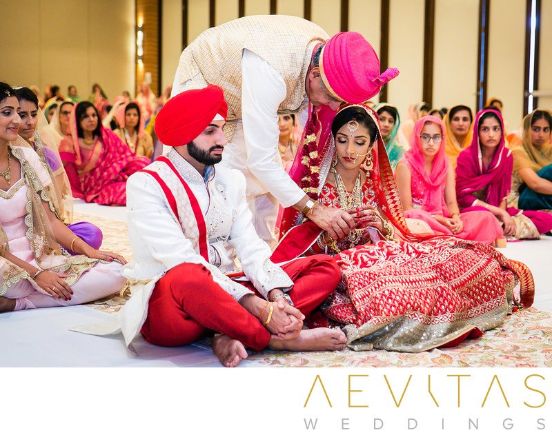 Exchange between father and bride at Sikh wedding