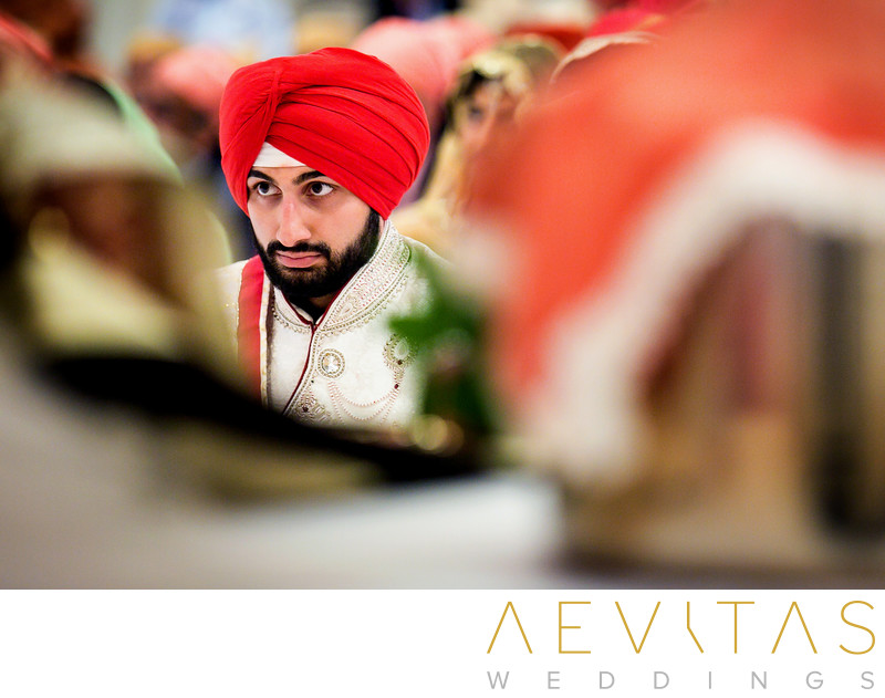 Creative photo of Sikh groom at wedding ceremony