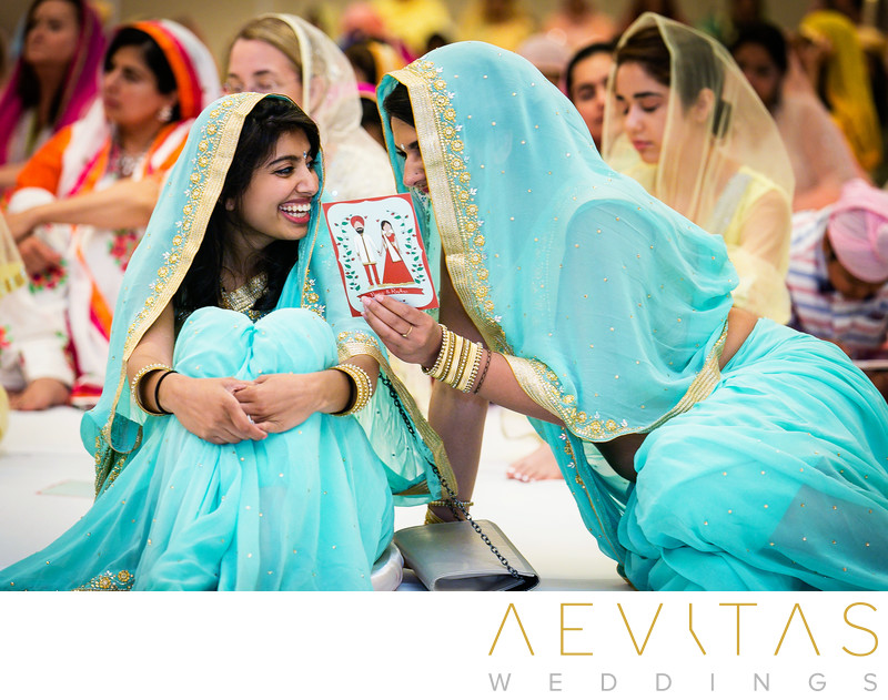 Bridesmaids laughing at Sikh wedding ceremony