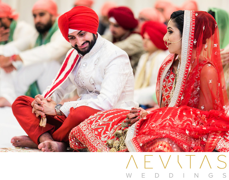 Candid moment between bride and groom at Sikh wedding