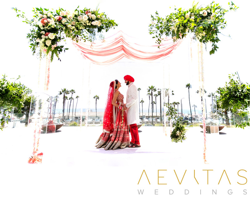 Couple portrait on mandap stage at Indian wedding