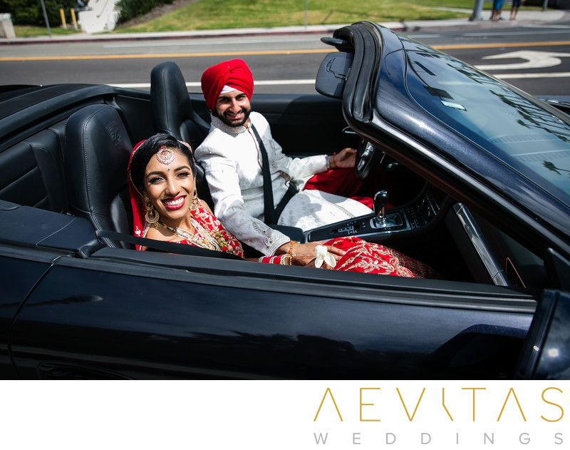 Indian bridal couple driving black Porsche in LA