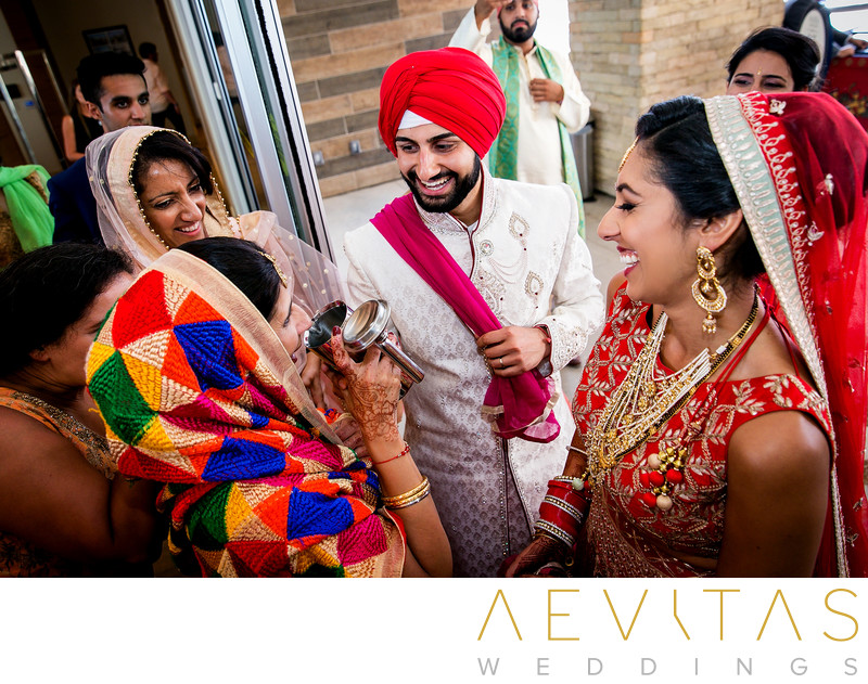 Candid photo of couple and mother at Indian wedding