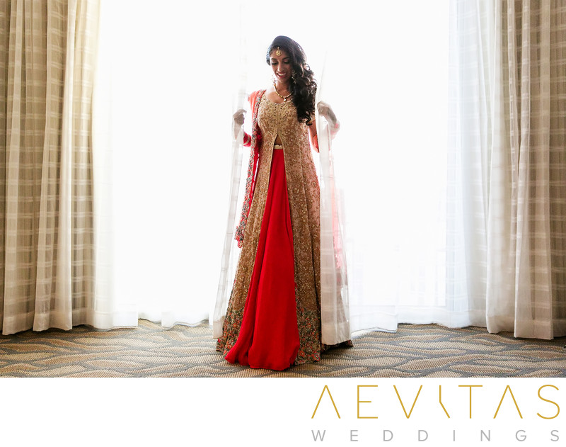 Indian bride portrait with hotel suite window drapes