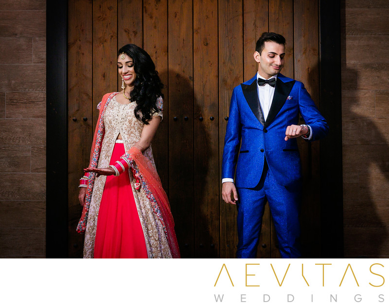 Creative Indian wedding couple portrait with wood wall