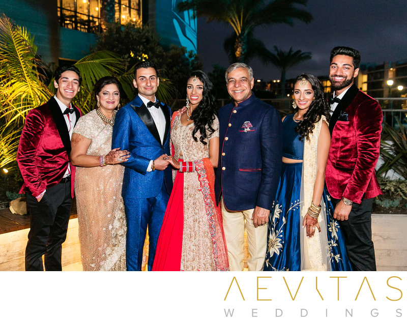 Couple with bride's family at Indian wedding reception