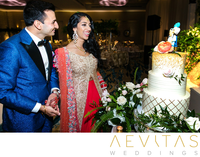 Couple admire wedding cake at Pasea Hotel and Spa