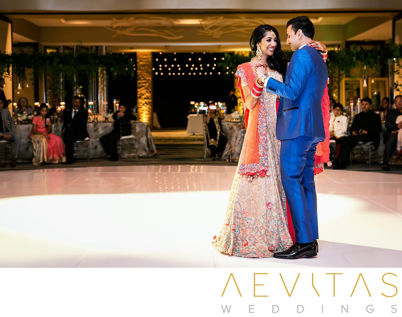 Couple dancing in ballroom at Pasea Hotel and Spa