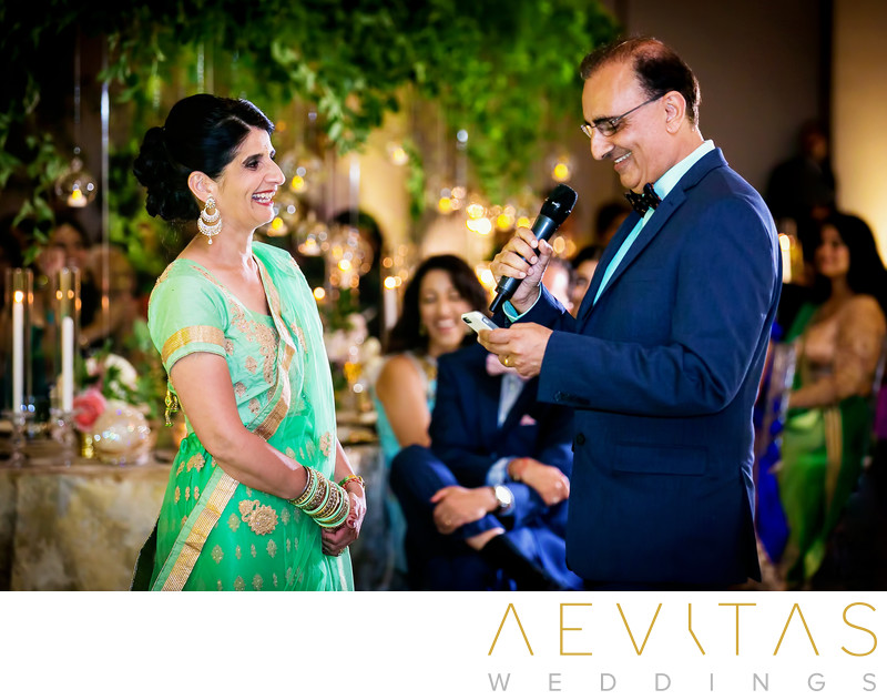 Father addresses wife at Indian wedding reception