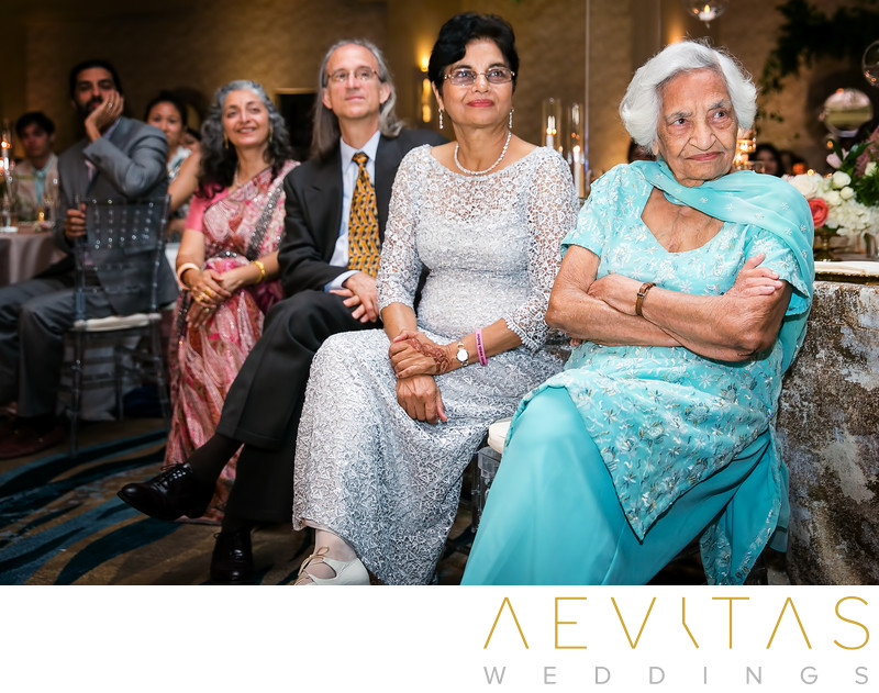 Family listen to speech at Indian wedding reception