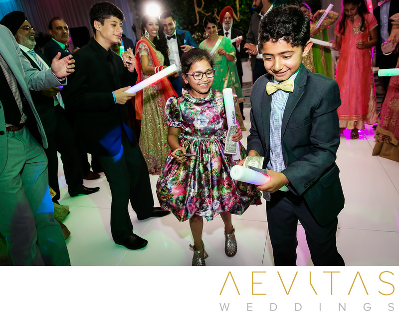 Young wedding guests at Pasea Hotel ballroom reception