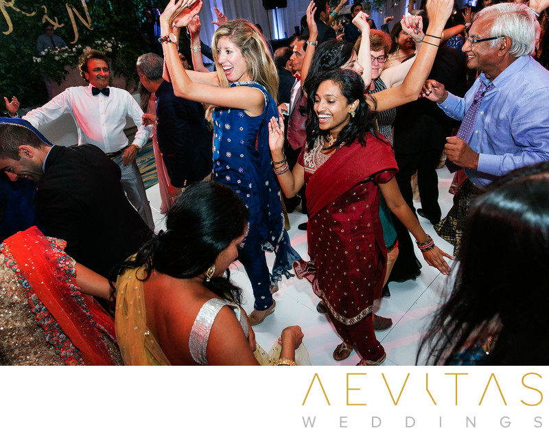 Action shot of guests dancing at Indian wedding