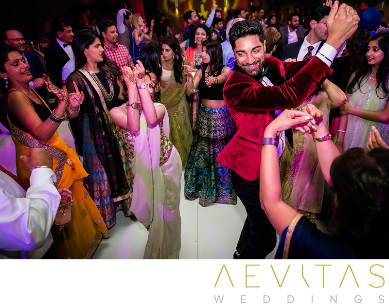 Brother dancing at Indian wedding reception party