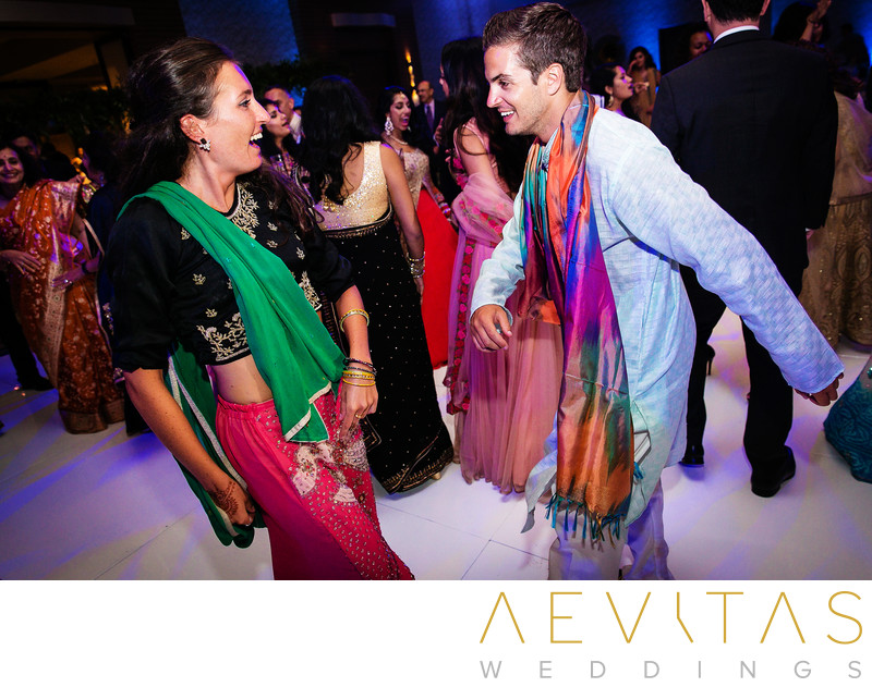 Wedding guests wearing Indian attire at reception