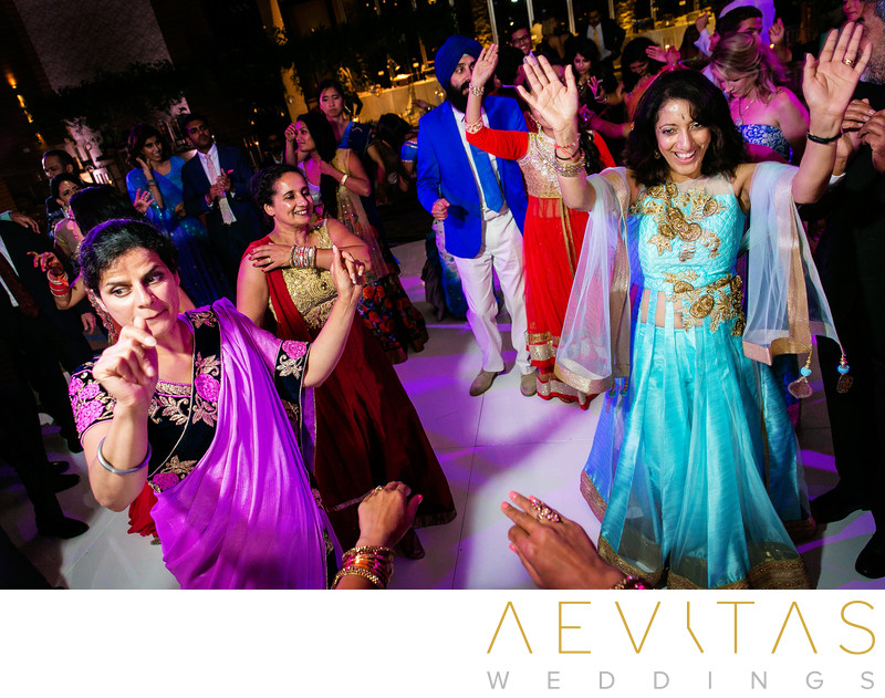 Women wearing Indian dresses at wedding reception