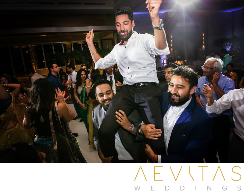Brother on shoulders at Indian wedding reception