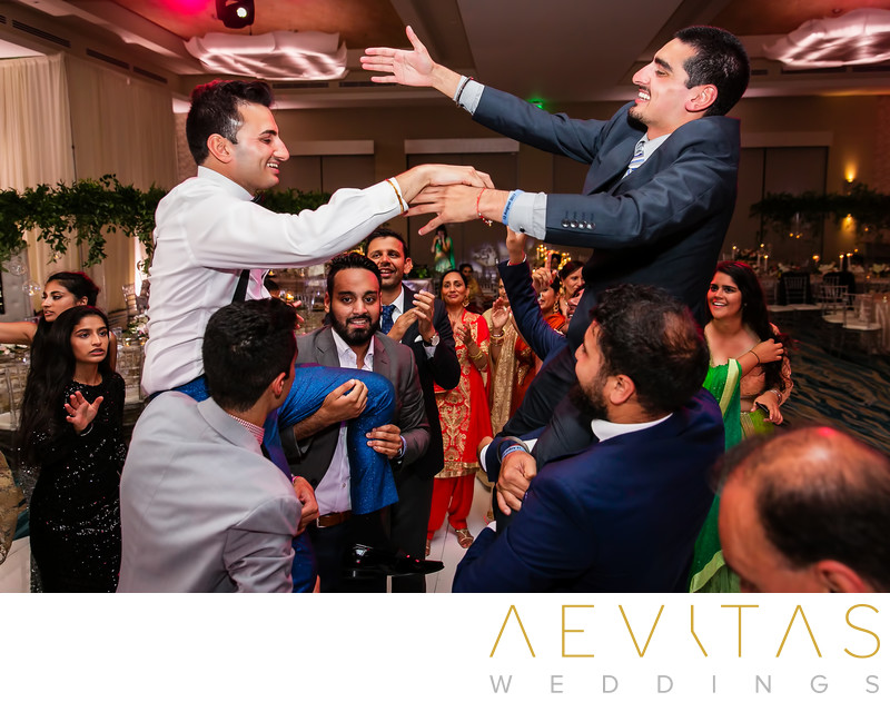 Groom and brother on shoulders at Pasea Hotel wedding