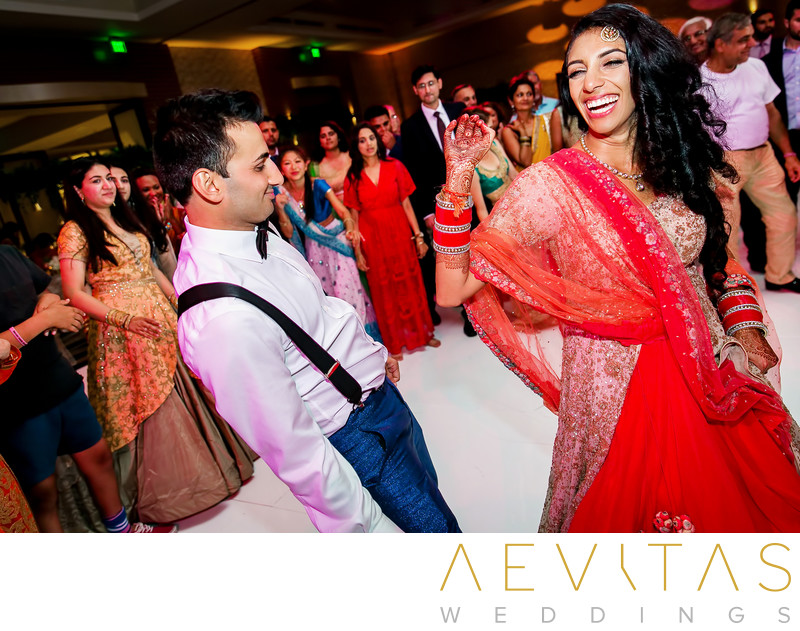 Funny bride and groom dancing photo at Indian wedding