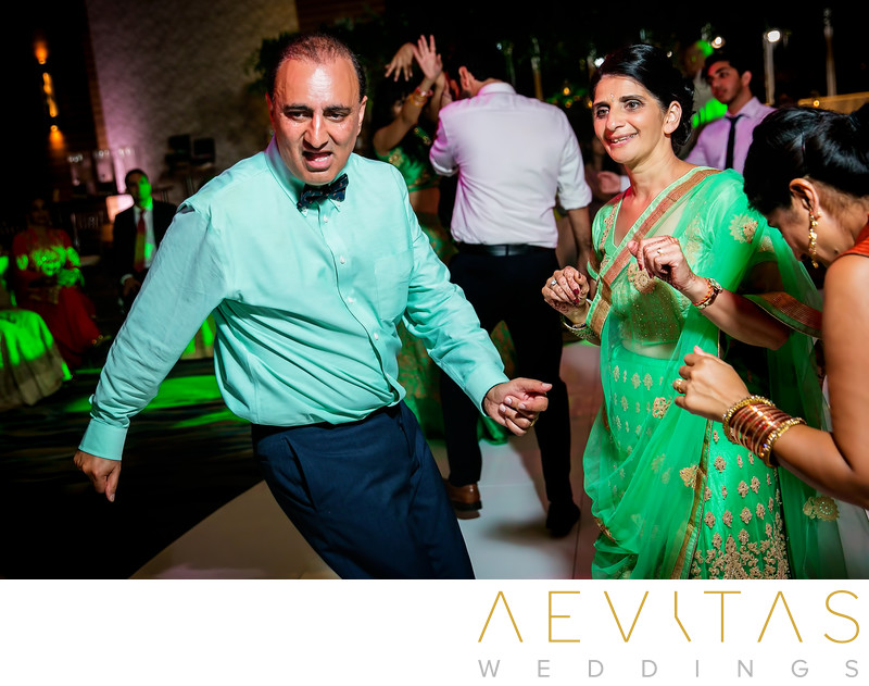 Father-of-the-groom dancing at Indian wedding party
