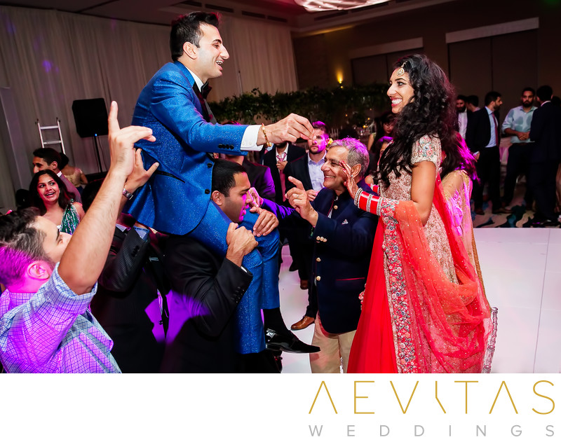 Playful moment bride and groom at Indian wedding party