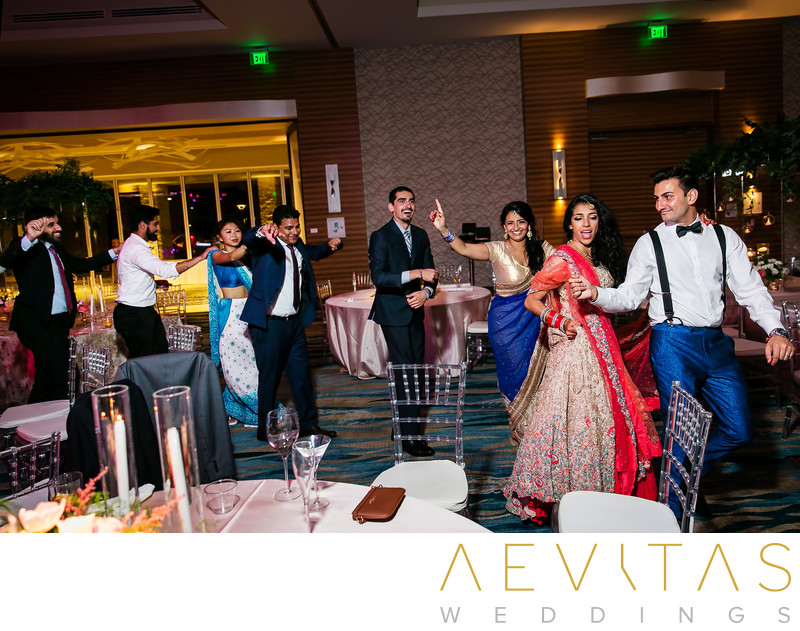 Bride and groom lead conga line at Indian wedding party