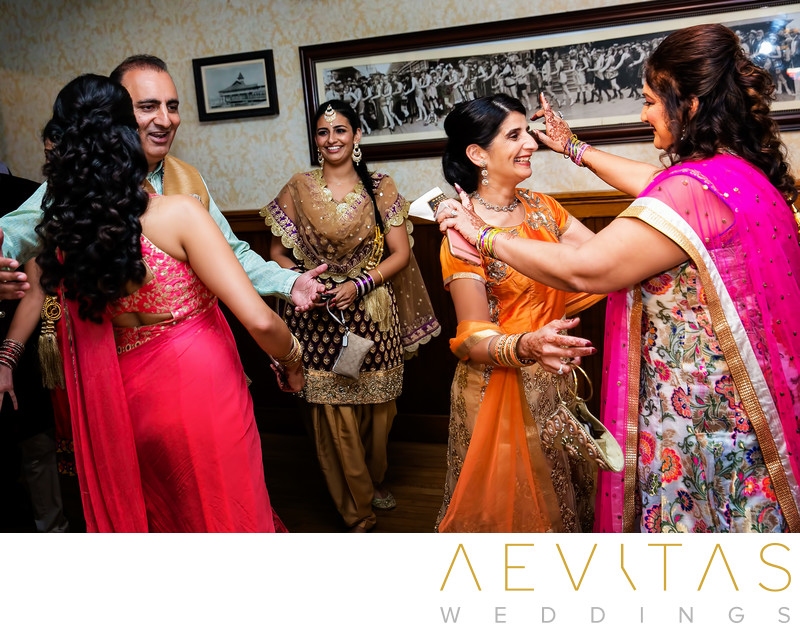 Guests embrace at Indian Sangeet in Newport Beach
