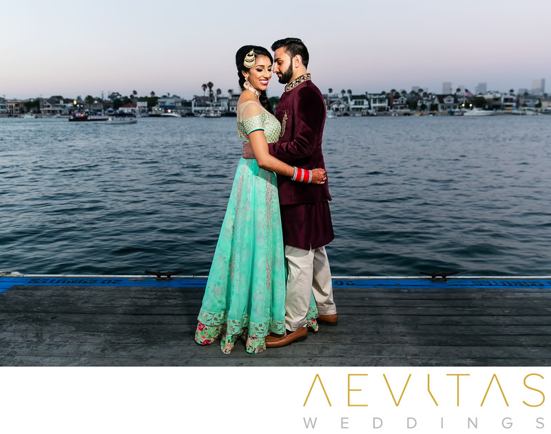 Indian couple portrait overlooking Newport Bay