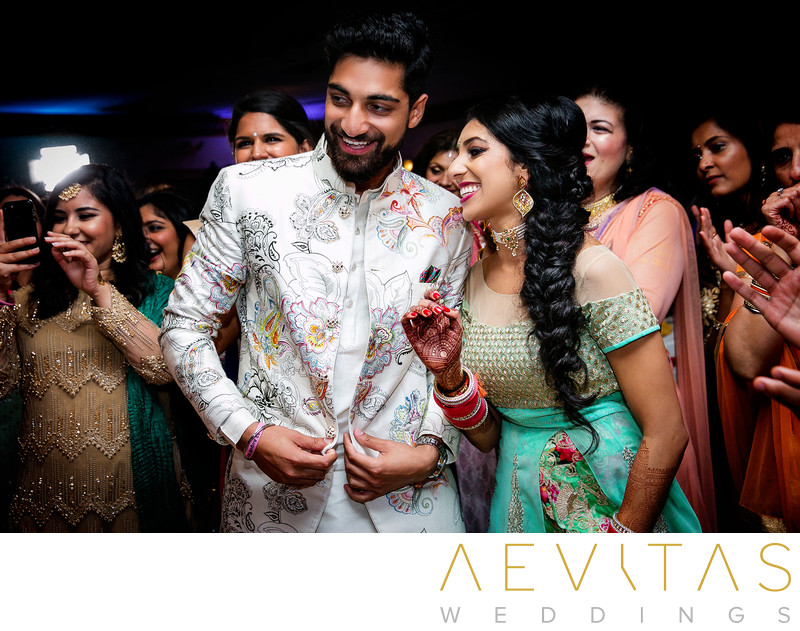 Bride and brother smiling at Sangeet wedding party